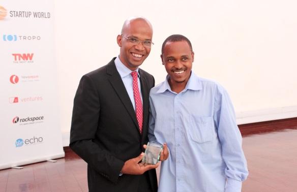 Winner Arnold Minde from SafariYetu receiving congratulations from Hon. Deputy Minister January Makamba