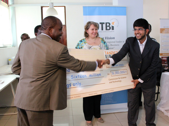 Taha Jiwadi from Bongo Live receiving grant cheque from Hon. Minister Prof. Makame M. Mbarawa - click to see all the photos